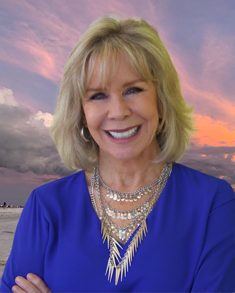 Linda Larsen Motivational-Speaker Half-Body Shot Against Sarasota Sunset for the Web