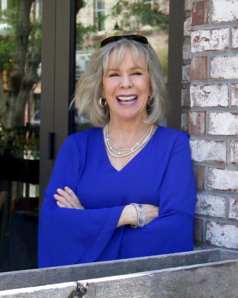 Motivational Speaker Linda Larsen Outside on Porch for Print