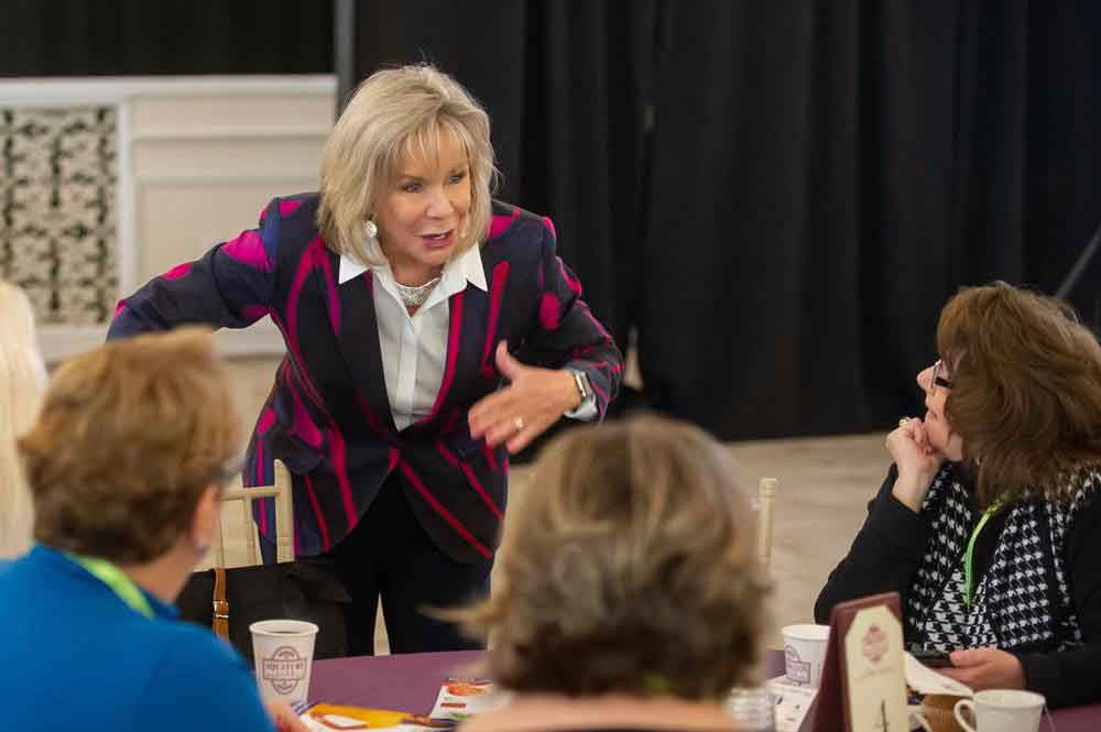 Motivational Speaker Linda Larsen Engages with Her Audience Up-close
