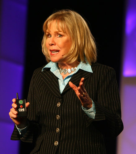 Motivational Speaker Linda Larsen with Cue Controller in Hand
