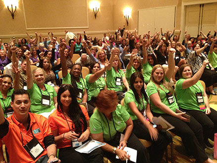 Motivational Speaker Linda Larsen Audience with Colorful Shirts Participation